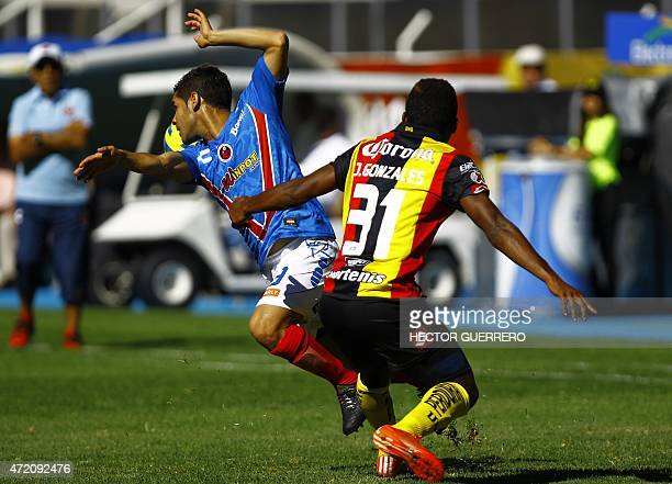 Jonathan Gonzales of Leones Negros vies for the ball with Daniel Villalba of Veracruz during their Mexican 2015 Clausura tournament football match at...