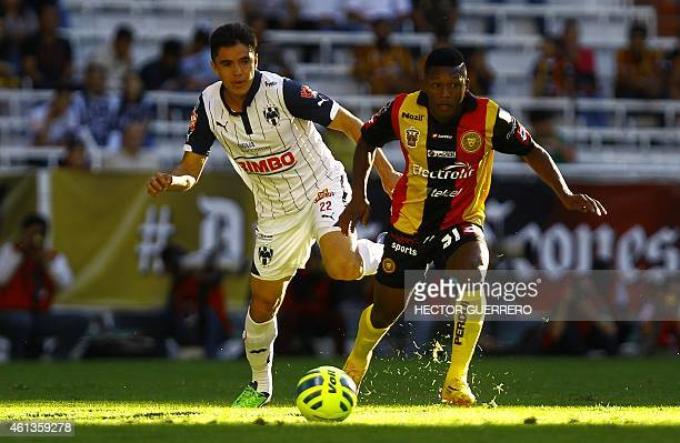 Jonathan Gonzales of Leones Negros vies for the ball with Efrain Velarde of Monterrey during their Mexican Clausura 2015 tournament football match at...