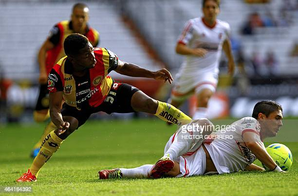 Jonathan Gonzales of Leones Negros vies for the ball with Javier Guemez of Tijuana during their Mexican Clausura 2015 tournament football match at...