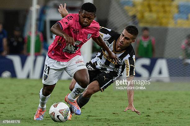 Jonathan Gonzalez of Ecuador's Independiente del Valle vies for the ball with Gabriel of Brazil's Botafogo during their 2014 Copa Libertadores...