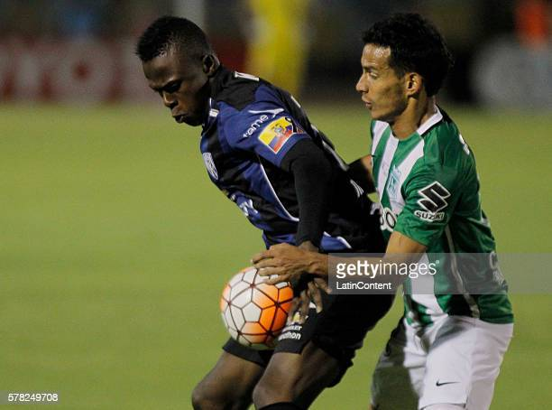 Jonathan Gonzalez of Independiente del Valle battles for the ball with Diego Arias of Atletico Nacional during a first leg final match between...