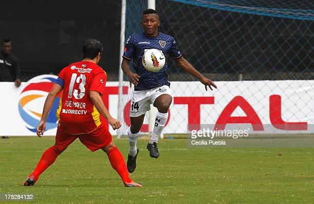 Jonathan Gonzalez of Independiente JT stuggles for the ball with Juan Fuenmayor of Anzoategui during a match between Independiente JT and Anzoategui...