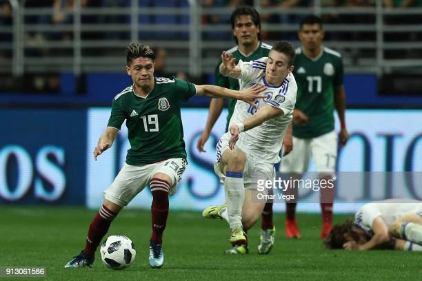 Jonathan Gonzalez of Mexico fights for the ball with Dino Besirovic of Bosnia and Herzegovina during the friendly match between Mexico and Bosnia and...