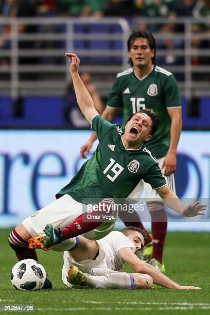 Jonathan Gonzalez of Mexico is fouled by Dino Besirovic of Bosnia during the friendly match between Mexico and Bosnia and Herzegovina at Alamodome...
