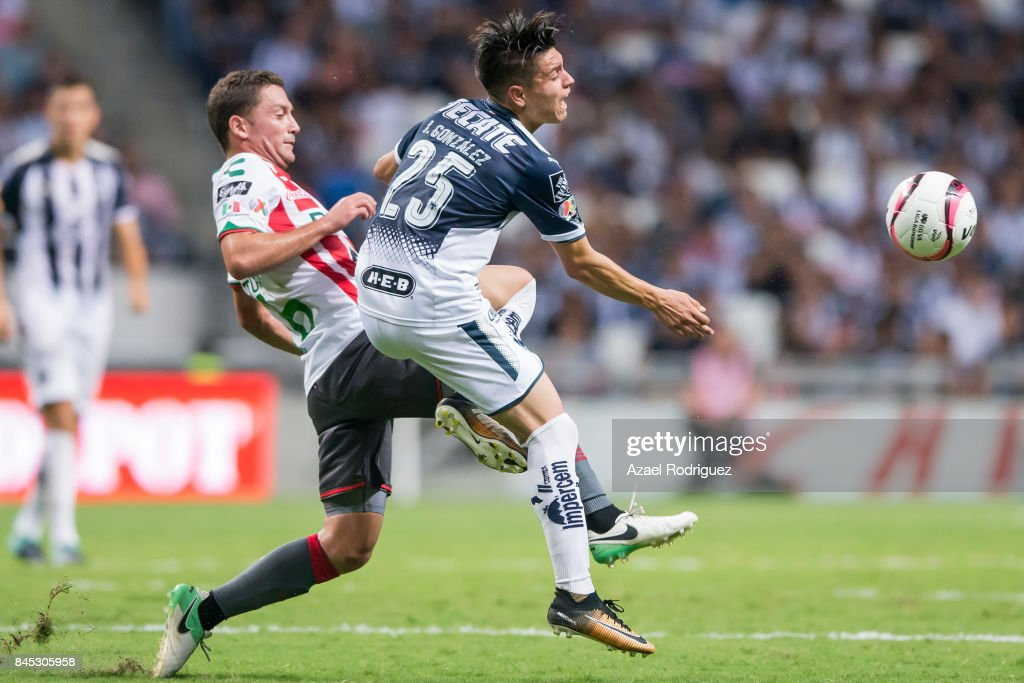 Jonathan Gonzalez of Monterrey fights for the ball with Manuel Iturra of Necaxa during the 8th round match between Monterrey and Necaxa as part of the Torneo Apertura 2017 Liga MX at BBVA Bancomer Stadium on September 9, 2017 in Monterrey, Mexico.