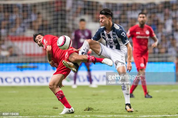 Jonathan Gonzalez of Monterrey fights for the ball with Rubens Sambueza of Toluca during the 6th round match between Monterrey and Toluca as part of...