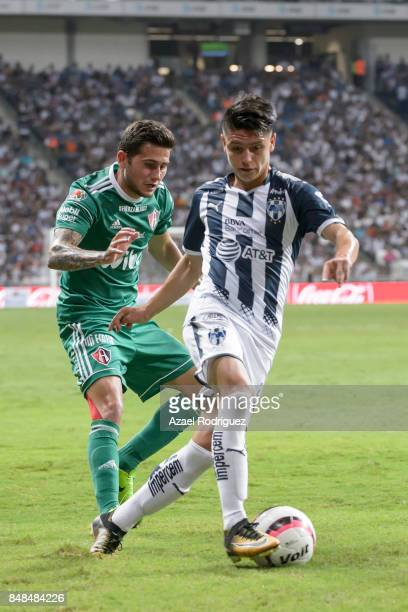Jonathan Gonzalez of Monterrey fights for the ball with Uvaldo Luna of Atlas during the 9th round match between Monterrey and Atlas as part of the...