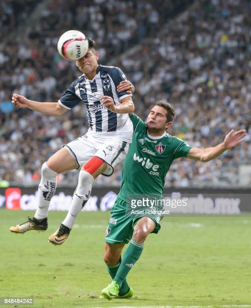 Jonathan Gonzalez of Monterrey heads the ball with Uvaldo Luna of Atlas during the 9th round match between Monterrey and Atlas as part of the Torneo...