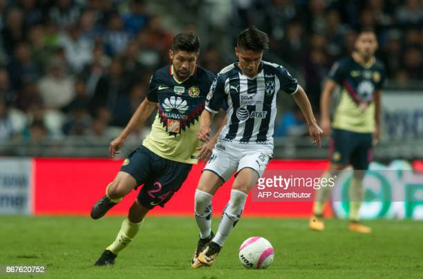 Jonathan Gonzalez of Monterrey is marked by Argentine Oribe Peralta of America during their Mexican Apertura football tournament match at the BBVA...