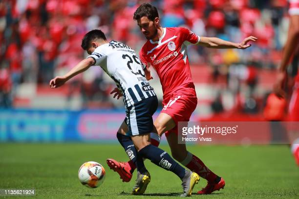 Jonathan Gonzalez of Monterrey struggles for the ball with Santiago Garcia of Toluca during the 13th round match between Toluca and Monterrey as part...