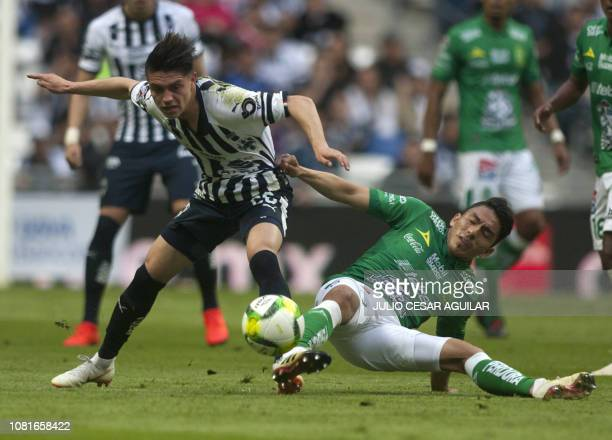 Jonathan Gonzalez of Monterrey vies for the ball with Angel Mena of Leon during their Mexican Clausura 2019 tournament football match at the BBVA...