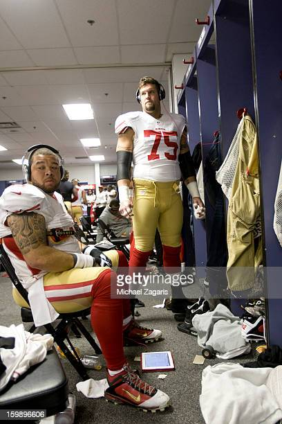 Jonathan Goodwin and Alex Boone of the San Francisco 49ers get ready in the locker room prior to the NFC Championship against the Atlanta Falcons...