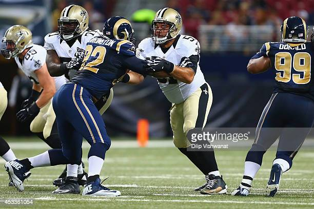 Jonathan Goodwin of the New Orleans Saints blocks against Alex Carrington of the St Louis Rams during the first half of a preseason game at the...