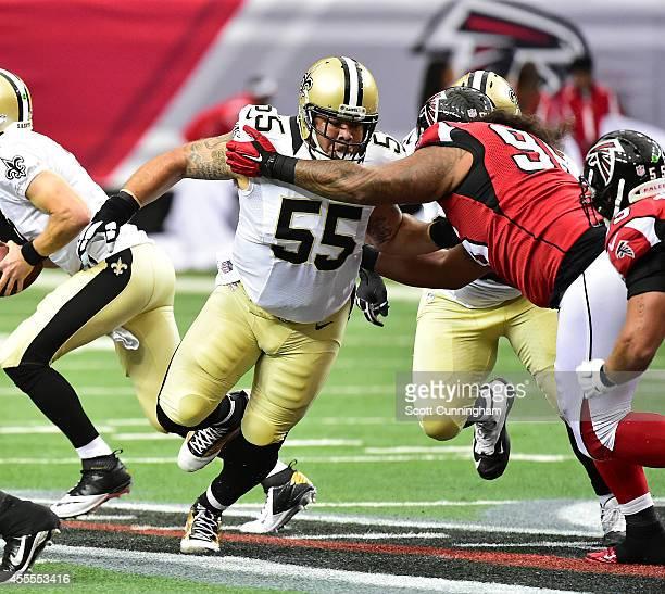 Jonathan Goodwin of the New Orleans Saints blocks against the Atlanta Falcons at the Georgia Dome on September 7 2014 in Atlanta Georgia