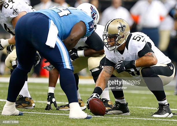 Jonathan Goodwin of the New Orleans Saints prepares to snap the ball during a preseason game against the Tennessee Titans at the MercedesBenz...