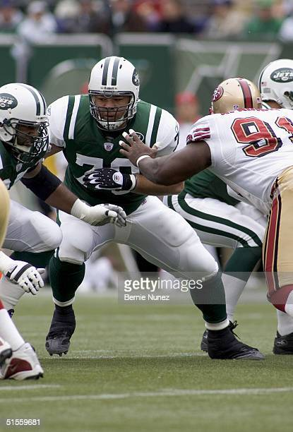 Jonathan Goodwin of the New York Jets pulls to block in the game against the San Francisco 49ers on October 17 2004 at Giants Stadium in East...