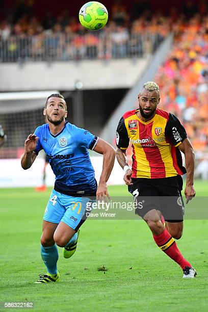 Jonathan Gradit of Tours and John Bostock of Lens during the Ligue 2 match between Racing Club de Lens and Tours FC at Stade BollaertDelelis on...