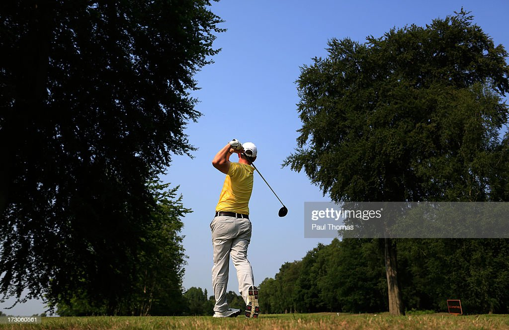 Jonathan Graham of Silloth on Solway Golf Club tees off on the 18th hole during the Lombard Trophy PGA National Pro-Am Championship Regional Final at Dunham Forest Golf and Country Golf Club on July 5, 2013 in Manchester, England.