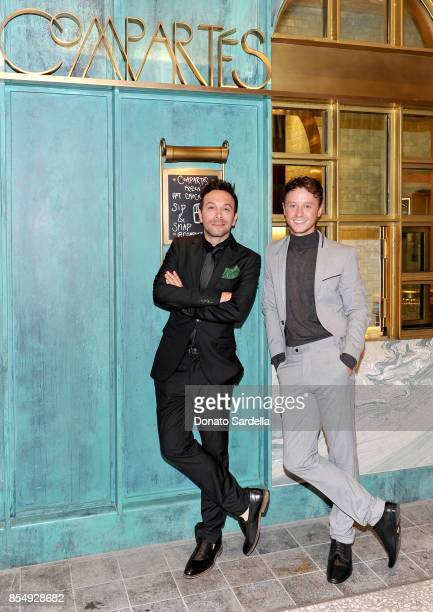 Jonathan Grahm and Jeffrey Postlethwaite celebrate the Compartes Chocolatier Century City Flagship Store Opening on September 27 2017 in Los Angeles...