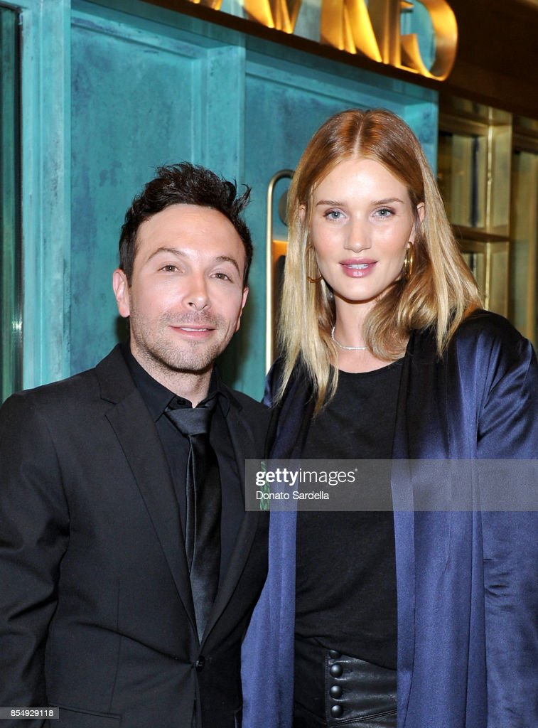 Jonathan Grahm (L) and Rosie Huntington-Whiteley celebrate the Compartes Chocolatier Century City Flagship Store Opening on September 27, 2017 in Los Angeles, California.