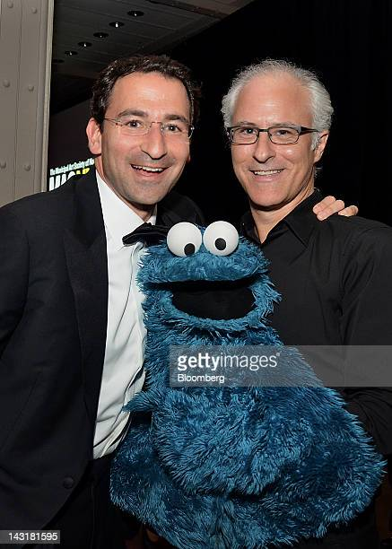 Jonathan Gray senior managing director of Blackstone Group LP left and Cookie Monster puppeteer David Rudman stand for a photograph at the Municipal...