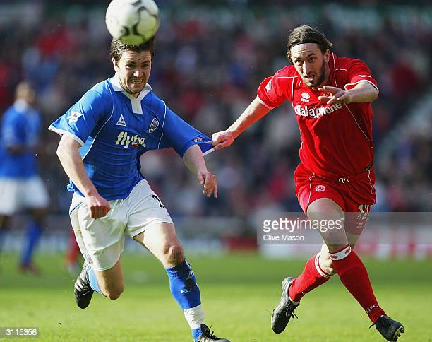 Jonathan Greening of Middlesbrough is tackled by Damien Johnson of Birmingham City during the FA Barclaycard Premiership match between Middlesbrough...