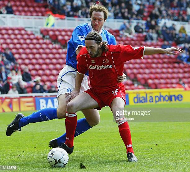 Jonathan Greening of Middlesbrough is tackled by Martin Taylor of Birmingham City during the FA Barclaycard Premiership match between Middlesbrough...