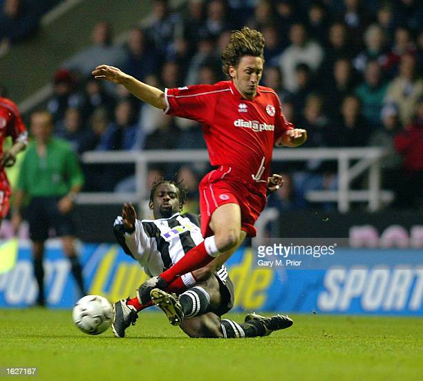 Jonathan Greening of Middlesbrough is tackled by Olivier Bernard of Newcastle United during the FA Barclaycard Premiership match between Newcastle...