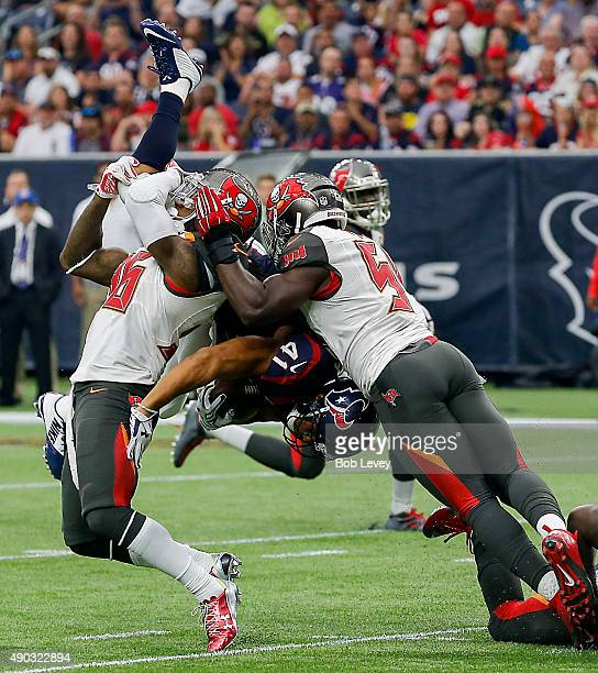 Jonathan Grimes of the Houston Texans is double teamed by DJ Swearinger of the Tampa Bay Buccaneers and Lavonte David in the first quarter at NRG...