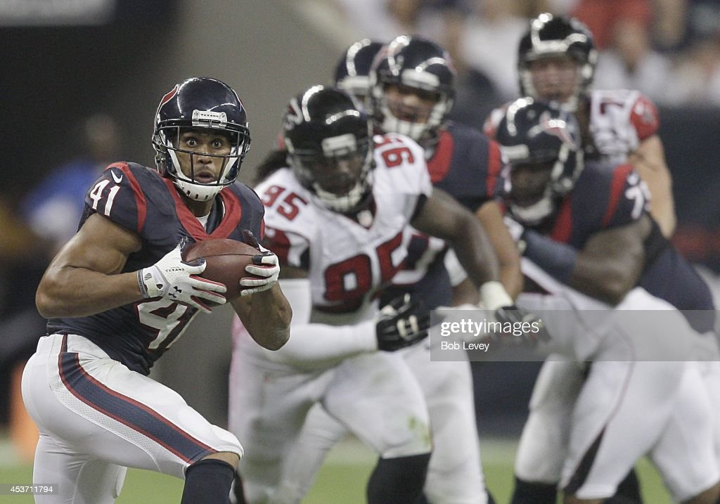Jonathan Grimes #41 of the Houston Texans makes a catch against the Atlanta Falcons in the second quarter in a pre-season NFL game on August 16, 2014 at NRG Stadium in Houston, Texas.