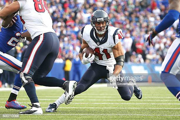 Jonathan Grimes of the Houston Texans runs the ball against the Buffalo Bills during the first half at Ralph Wilson Stadium on December 6 2015 in...