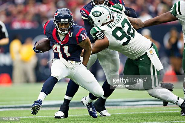 Jonathan Grimes of the Houston Texans runs the ball during a game against the New York Jets at NRG Stadium on November 22 2015 in Houston Texas The...