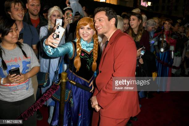 Jonathan Groff poses with fans at the premiere of Disney's Frozen 2 at Dolby Theatre on November 07 2019 in Hollywood California