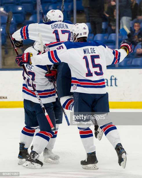 Jonathan Gruden Jake Wise and Bode Wilde of the USA Nationals celebrate a third period goal by Tyler Weiss against the Russian Nationals during the...