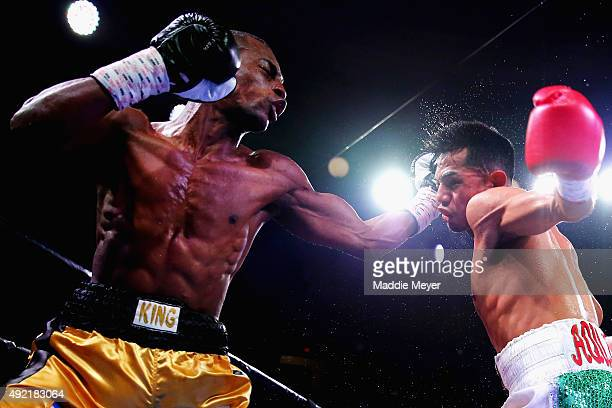 Jonathan Guzman throws a right at Danny Aquino during their Super Bantamweight bout on October 10, 2015 at Lowell Memorial Auditorium in Lowell,...