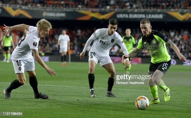 Jonathan Hayes of Celtic is challenges by Daniel Wass and Ferran Torres of Valencia during the UEFA Europa League Round of 32 Second Leg match...