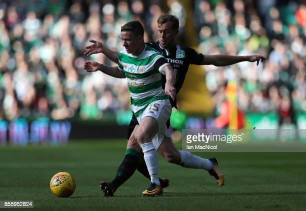 Jonathan Hayes of Celtic vies with Steven Whittaker of Hibernian during the Ladbrokes Scottish Premiership match between Celtic and Hibernian at...