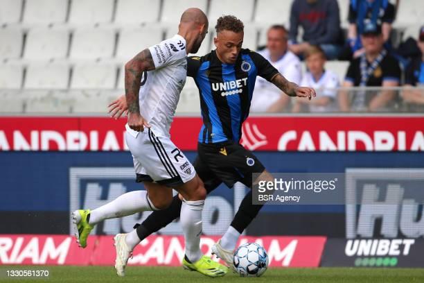 Jonathan Heris of KAS Eupen, Noa Lang of Club Brugge during the Belgian Jupiler Pro League match between Club Brugge and KAS Eupen at Jan...