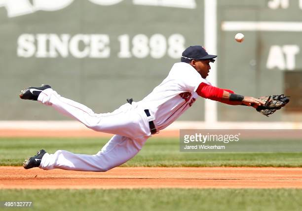 Jonathan Herrera of the Boston Red Sox misses diving for a ball in the first inning against the Tampa Bay Rays during the game at Fenway Park on June...