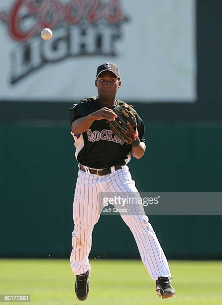 Jonathan Herrera of the Colorado Rockies fields the ball against the Milwaukee Brewers during a spring training game at Hi Corbett Field on March 1...