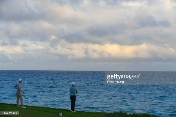 Jonathan Hodge and Chris Baker look out at the ocean while waiting to tee off during the second round of the Webcom Tour's The Bahamas Great Exuma...