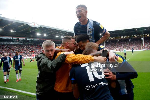 Jonathan Hogg jumps over the top of his team mates after Josh Koroma scores the opening goal for Huddersfield Town during the Sky Bet Championship...
