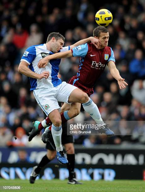 Jonathan Hogg of Aston Villa competes in the air with David Dunn of Blackburn Rovers during the Barclays Premier League match between Blackburn...