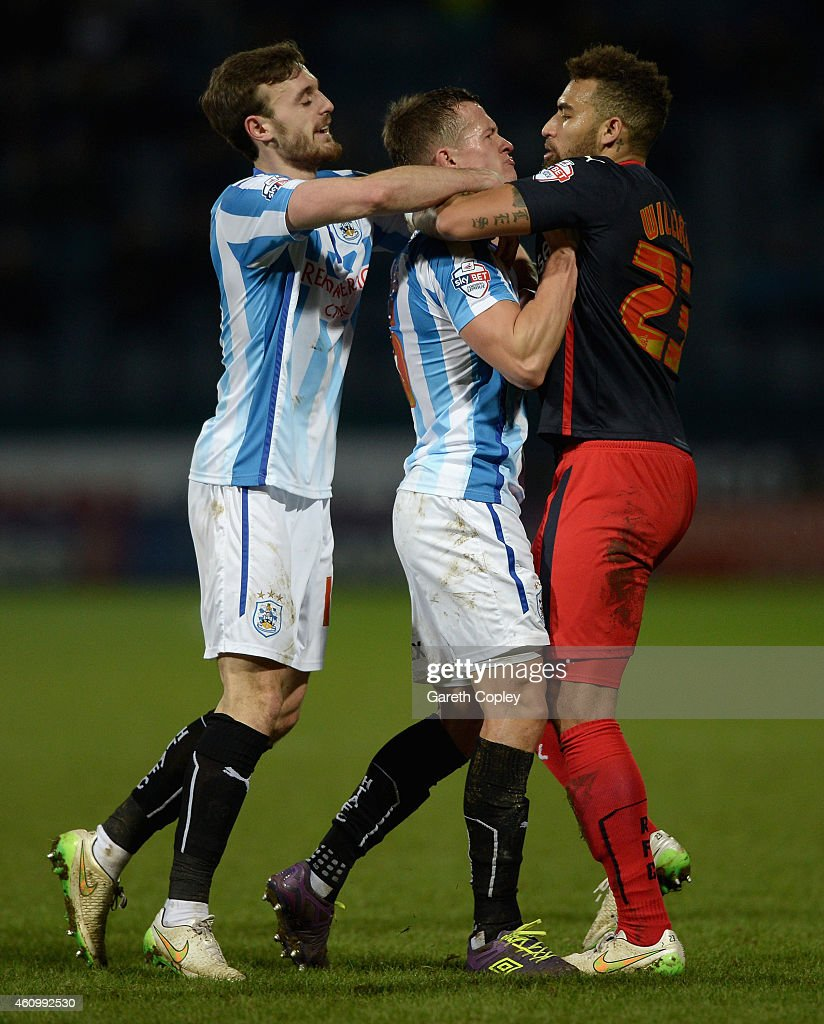 Jonathan Hogg of Huddersfield confronts Danny Williams of Reading during the FA Cup Third Round match between Huddersfield Town and Reading at Galpharm Stadium on January 3, 2015 in Huddersfield, England.