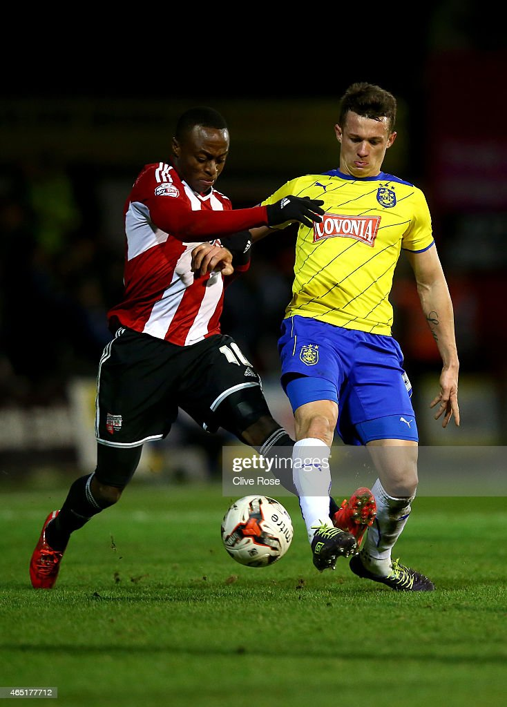 Jonathan Hogg of Huddersfield is challenged by Moses Odubajo of Brentford during the Sky Bet Championship match between Brentford and Huddersfield Town at Griffin Park on March 3, 2015 in Brentford, England.