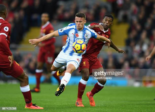 Jonathan Hogg of Huddersfield Town and Georginio Wijnaldum of Liverpool battle for possession during the Premier League match between Liverpool and...