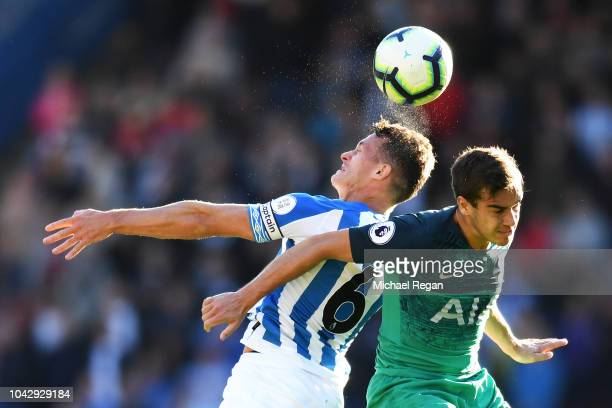 Jonathan Hogg of Huddersfield Town and Harry Winks of Tottenham Hotspur compete for a header during the Premier League match between Huddersfield...