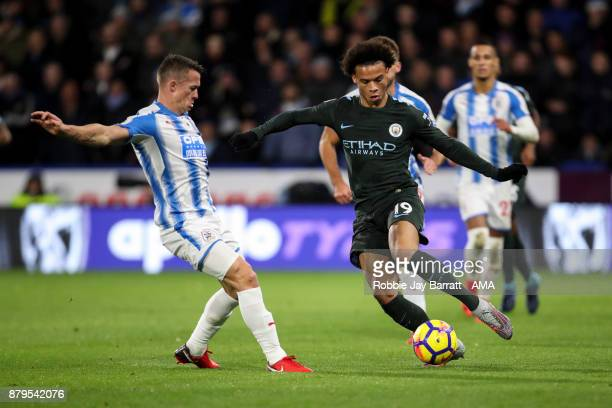 Jonathan Hogg of Huddersfield Town and Leroy Sane of Manchester City during the Premier League match between Huddersfield Town and Manchester City at...
