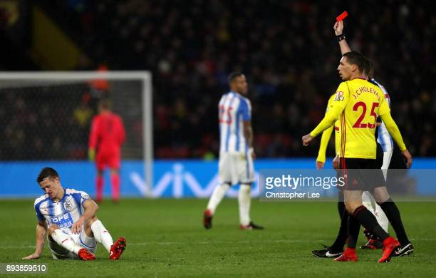 Jonathan Hogg of Huddersfield Town by referee Michael Oliver during the Premier League match between Watford and Huddersfield Town at Vicarage Road...
