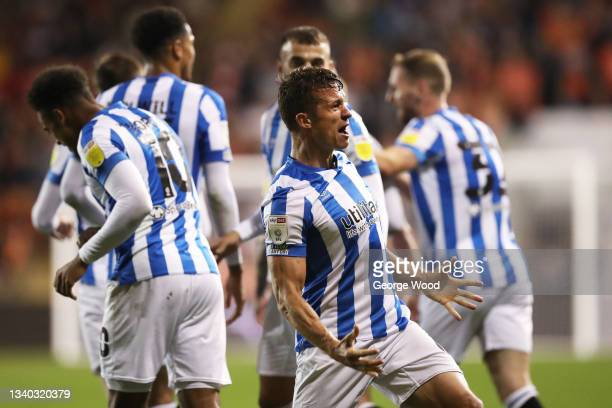 Jonathan Hogg of Huddersfield Town celebrates after scoring their side's third goal during the Sky Bet Championship match between Blackpool and...